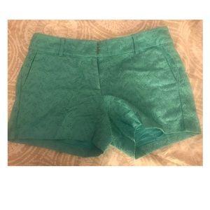 Green Ann Taylor eyelet shorts.